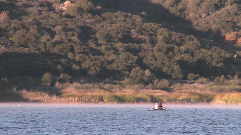 Wide view of two people rowing a double scull on Lake Casitas in Oak View, California Footage
