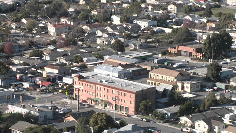Zoom out from above the urban area on Ventura Avenue in Ventura, California Footage