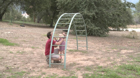 Time lapse of a father and daughter playing on a monkey bars in Ojai, California Footage