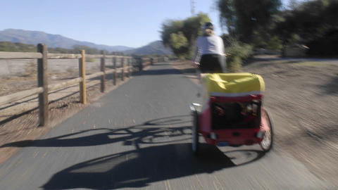 Point of view time lapse of a women riding a bike towing... Stock Video Footage