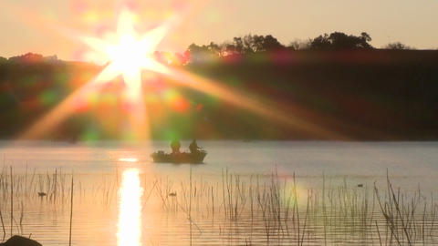 Fishing boat at sunrise on Lake Casitas Recreation Area... Stock Video Footage