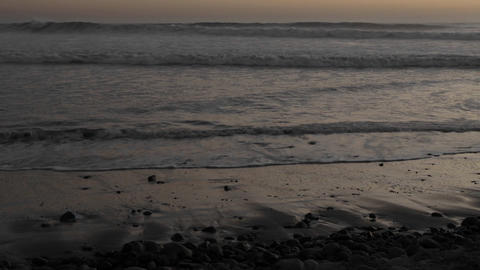 Time lapse of waves washing on shore at sunset in... Stock Video Footage