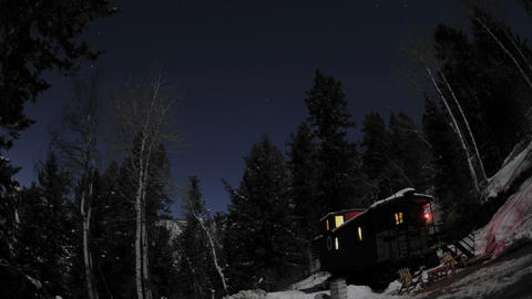 Time lapse of night sky above a train caboose at Strawberry Hot Springs, Colorado Footage