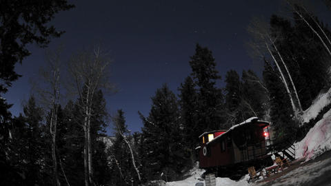 Time lapse of night sky above a train caboose at... Stock Video Footage