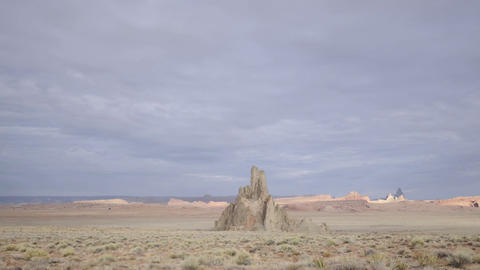 Time lapse of clouds passing over Church Rock and Comb... Stock Video Footage