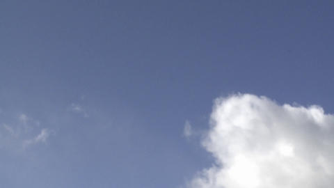 Time lapse of spring clouds in a blue sky above Oak View, California Live Action
