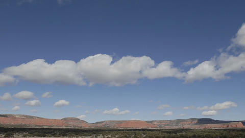 Panning time lapse of winter clouds in a blue sky over... Stock Video Footage