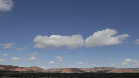Panning time lapse of winter clouds in a blue sky over the Continental Divide in New Mexico Footage
