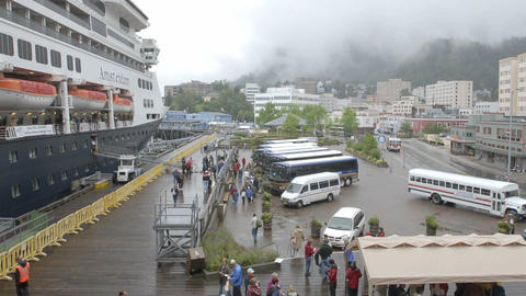 Time lapse of passengers disembarking from a cruise ship in Juneau, Alaska Footage
