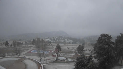 Time lapse of clouds and snow in Rocky Mountain National Park from the Stanley Hotel in Estes Park Footage
