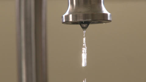 Close up of water dripping fast from a faucet in Oak View, California Footage