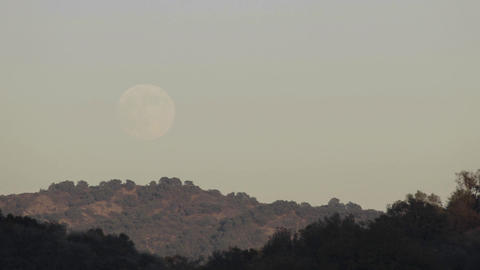 Time lapse of full moon rising over a landscape in Oak... Stock Video Footage