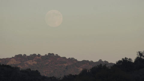 Time lapse of full moon rising over a landscape in Oak View, California Footage