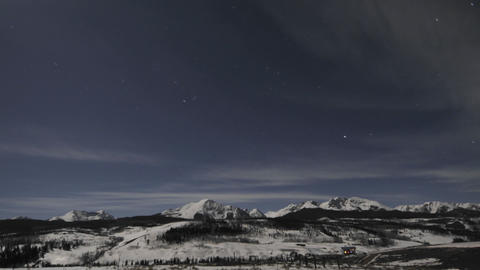 Time lapse of night sky, clouds and full moon over the Gore Range in Silverthorne, Colorado Footage