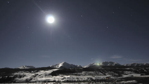 Time lapse of night sky, clouds and full moon over the... Stock Video Footage