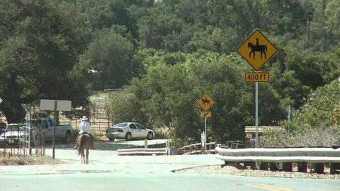 Horse rider next to a horse crossing sign at the Ventura... Stock Video Footage