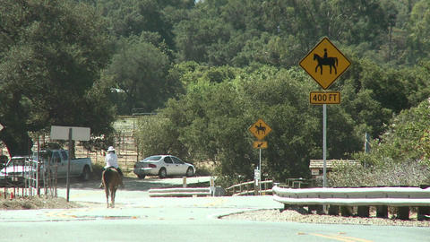 Horse rider next to a horse crossing sign at the Ventura River Preserve in Ojai, California Footage