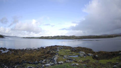 Time lapse of clouds blowing over the water at Doe Castle... Stock Video Footage