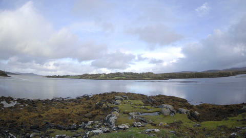 Time lapse of clouds blowing over the water at Doe Castle near Creeslough in County Donegal, Ireland Footage
