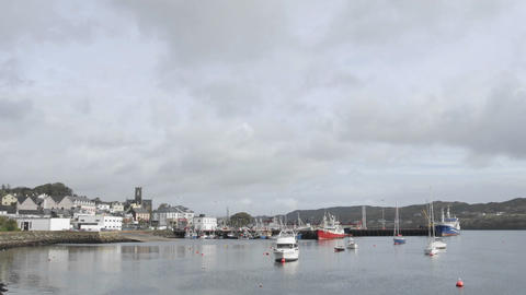Time lapse of clouds and boats blowing in the wind in Killybeg Harbour, Ireland Footage