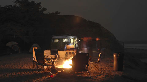 Time lapse of people around a campfire at Jalama Beach County Park, California Footage