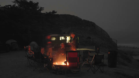 Time lapse of people around a campfire at Jalama Beach... Stock Video Footage