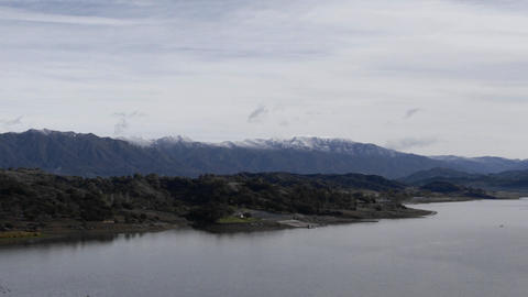 Time lapse of clouds blowing over Lake Casitas and the... Stock Video Footage