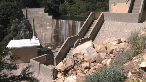 Wide side view of water spilling over the Matilija Dam in... Stock Video Footage