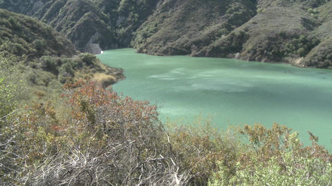 Panning wide view of water behind the Matilija Dam in... Stock Video Footage