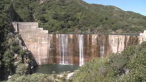 Pan front view of water spilling over the Matilija Dam in... Stock Video Footage
