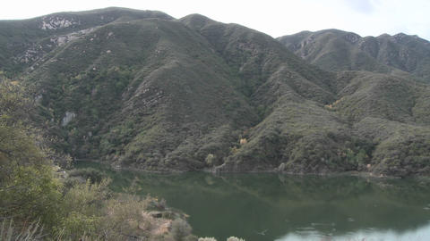 Pan of mountains and water in Matilija Reservoir in Ojai,... Stock Video Footage