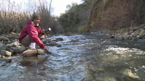 Man testing the water flowing in San Antonio Creek in Ojai, California Footage