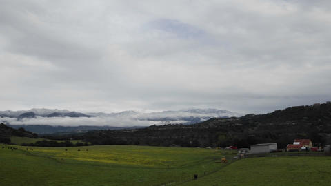 Zoom in time lapse of storm clearing over the mountains... Stock Video Footage