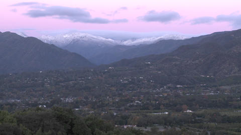 Zoom in of sunrise on the snow-covered Santa Ynez... Stock Video Footage