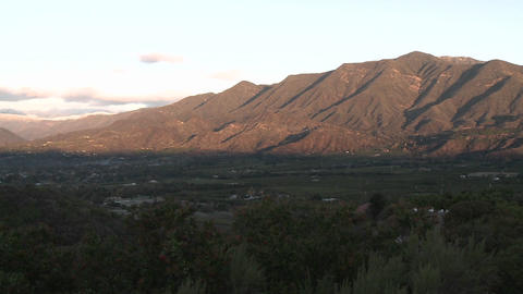 Wide pan of sunrise on the snow-covered Santa Ynez... Stock Video Footage