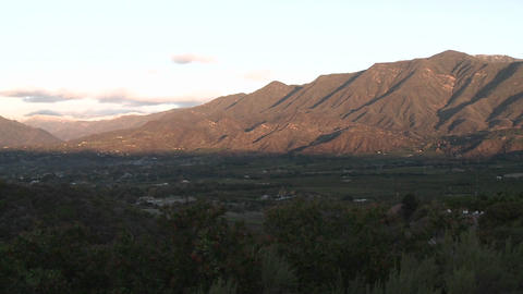 Wide pan of sunrise on the snow-covered Santa Ynez Mountains above Ojai, California Footage