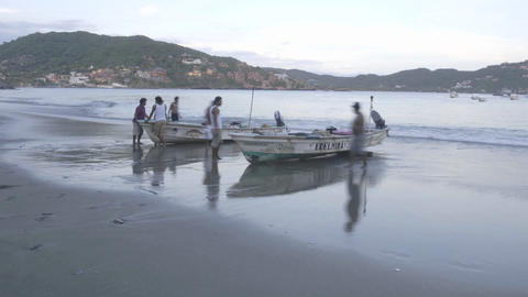 Close up time lapse of fishing boats launching from Playa... Stock Video Footage