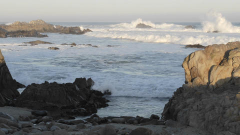 Panning time lapse of waves breaking on Point Pinos in Pacific Grove, California Footage