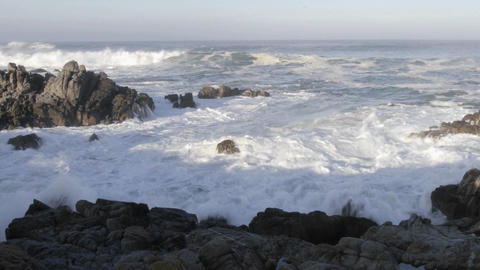 Panning time lapse of waves breaking on the rocks at... Stock Video Footage