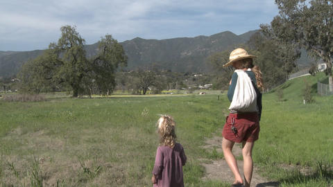 A woman and girl walking through a restored wetlands at the Ojai Meadow Preserve in Ojai, California Footage