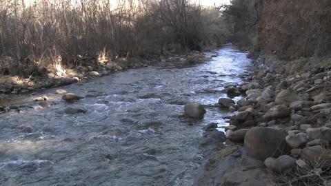 Pan of people testing the water flowing in San Antonio... Stock Video Footage