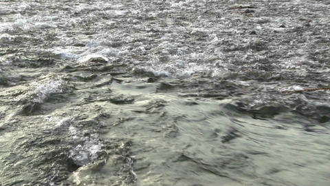 Zoom of water flowing out of the Ventura River estuary at... Stock Video Footage
