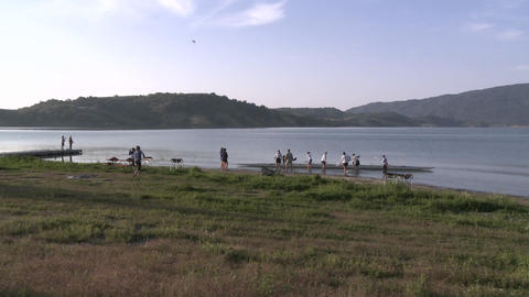 Time lapse of eight person rowing sweep entering the water on Lake Casitas in Oak View, California Footage