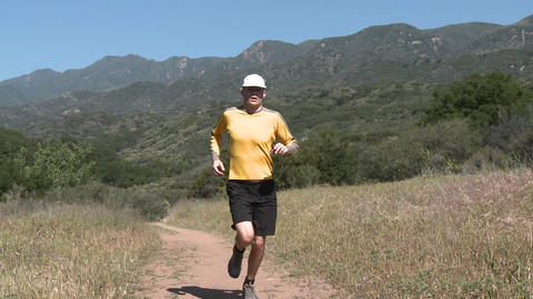 A man trail running on the Ventura River Preserve in Ojai, California Footage
