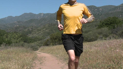 A man trail running on the Ventura River Preserve in... Stock Video Footage