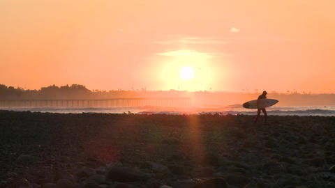 Wide surfer silhouette getting into the water during... Stock Video Footage