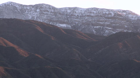 Zoom out of the snow covered Topatopa Mountain above Ojai, California Footage
