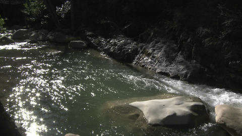 Light reflecting off the North Fork Matilija Creek above... Stock Video Footage