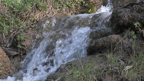 Zoom out of a small waterfall on the North Fork Matilija Creek above Ojai, California Footage