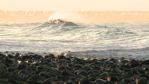 Pan of a wave breaking at Surfers Point in Ventura, California Footage